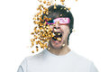 Man in stereo glasses eating popcorn Royalty Free Stock Photo