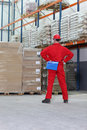 Man in storage warehouse Royalty Free Stock Image