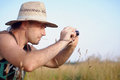The man in a straw hat with the camera Royalty Free Stock Photography