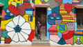 Man at street art melaka standing with wall painting background malacca Royalty Free Stock Photo