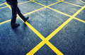 Man street walking walk on wet asphalt with marked yellow lines Stock Photography