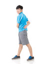 Man stretch asian sport young and warm full length portrait isolated on white background Royalty Free Stock Image