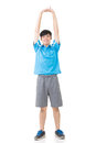 Man stretch asian sport young and warm full length portrait isolated on white background Stock Photography
