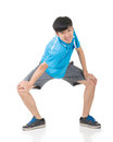 Man stretch asian sport young and warm full length portrait isolated on white background Royalty Free Stock Photo