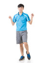 Man stretch asian sport young and warm full length portrait isolated on white background Royalty Free Stock Images