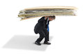 Man struggling under big pile of paperwork a business is the pressure a giant Royalty Free Stock Photography
