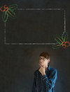 Man student or teacher hand on chin with christmas holly menu to do checklist business blackboard background Stock Photography