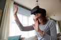 Man In Studio Wearing Virtual Reality Headset Playing Game Royalty Free Stock Photo