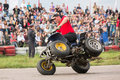 Man stunt shows on a quad bike moscow aug festival of art and film prometheus in tushino august in moscow russia the Stock Photography