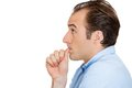 Man sucking thumb closeup side view profile portrait of with finger in mouth biting fingernail in stress deep thought isolated on Stock Image