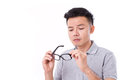 Man suffers from short-sightedness, myopia Royalty Free Stock Photo