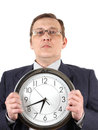 Man in suit with clock Royalty Free Stock Photos