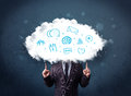 Man in suit with cloud head and blue icons on grungy background Royalty Free Stock Photos