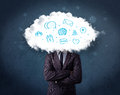 Man in suit with cloud head and blue icons on grungy background Royalty Free Stock Photo