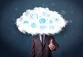 Man in suit with cloud head and blue icons on grungy background Stock Photo