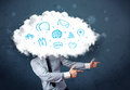 Man in suit with cloud head and blue icons on grungy background Stock Image