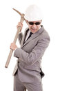 Man in suit displaying pick axe this image has attached release Royalty Free Stock Images
