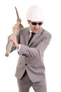 Man in suit displaying pick axe this image has attached release Royalty Free Stock Image