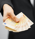 Man in suit with euro cash money picture of Royalty Free Stock Photo