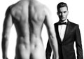 Man in suit in front of nude man stylish black athletic male model Stock Photos