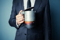 Man in suit holding a moka pot young is coffee Royalty Free Stock Images