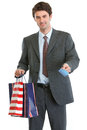 Man in suit holding shopping bags and credit card Stock Image