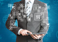Man in suit holding tablet pc Royalty Free Stock Photo