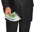 Man in a suit holds out a number of euro banknotes on white background Stock Photo