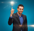 Man in suit with light bulb picture of Royalty Free Stock Photo