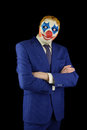 Man in a suit and mask of a clown Royalty Free Stock Photo