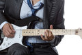 Man in suit playing electric guitar isolated on white and tie Royalty Free Stock Photo