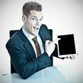 Man in suit with tablet a a a computer pointing at the screen Royalty Free Stock Image