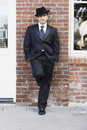 Man in Suit and Tie Leaning against Wall Royalty Free Stock Images