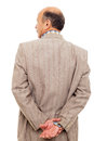 Man in the suit turned his back, taking  thoughtfully his wrist Royalty Free Stock Photo