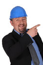 Man in suit wearing hard hat funny Stock Photo
