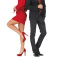 Man in suit and woman in red dress fashion beauty clothing concept men women Stock Photo