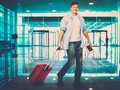 Man with suitcase in airport Royalty Free Stock Photo