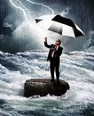 Man sunglasses holding umbrella reaches to sky attracts lightening bolt sky as rains stands lone rock middle ragin waterway river Royalty Free Stock Images