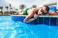 The man sunning by the pool in sunny day Royalty Free Stock Photo