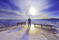 Man in sunrise me standing up badlands national park south dakota during winter Royalty Free Stock Photo