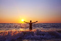 Man at sunset silhouette of a happy admires the on the sea healthy lifestyle freedom and inspiration Royalty Free Stock Photos
