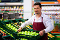 Man in supermarket as shop assistant Royalty Free Stock Photo