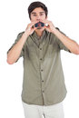 Man surprised with binoculars on a white background Stock Photography