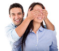 Man surprising his girlfriend Stock Image