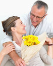 Man surprising his wife with flowers Royalty Free Stock Image