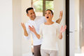 Man surprising his wife happy mid age men with a new house Stock Image