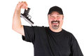 Man surrender holds his gun up properly big guy with a goatee and black shirt with on left hand smiling friendly Stock Images