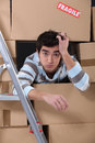 Man surrounded cardboard boxes Royalty Free Stock Photo