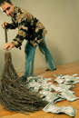 Man sweeping dollar banknotes Royalty Free Stock Photos