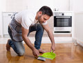 Man sweeping dust on parquet Royalty Free Stock Photo